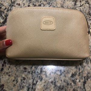 Gold Bric's cosmetic bag